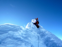 Edita on top of Manaslu WFP flag (photo by Ole)