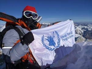 Me with my WFP flag on the summit of Cho Oyu in 2011