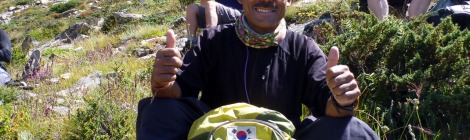 A smiling Dorje Khatri gives the thumbs up on the way to Cho Oyu